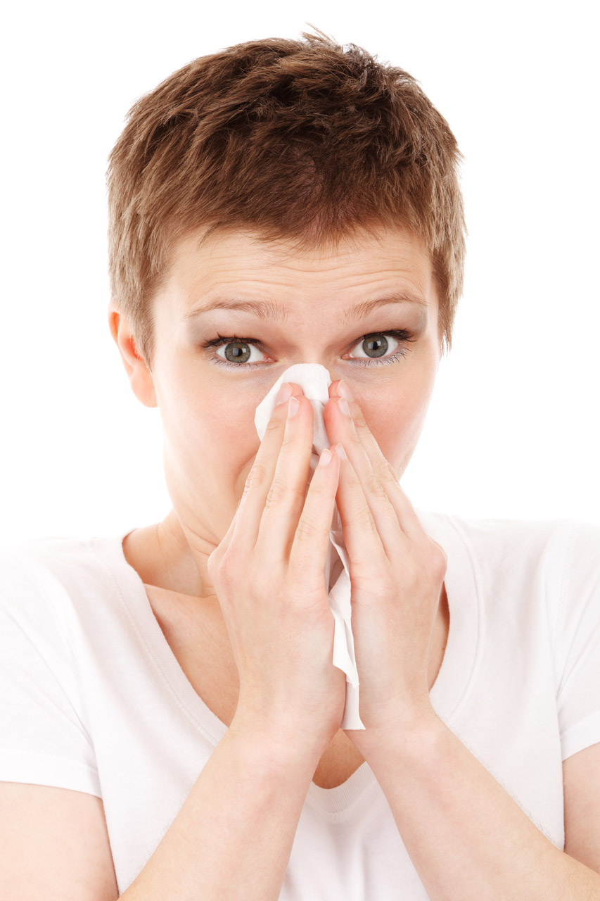 Woman_with_tissues_sneeze.jpg